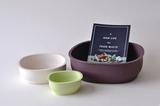 "An image of three bowls made from food waste: white, green, and brown. The brown bowl has a ""A New Life For Food Waste"" pamphlet in it."